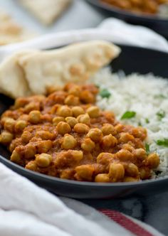 Slow Cooker Vegan Chana Masala. Chickpeas cooked in a fragrant, spiced tomato sauce. Make in the morning for dinner at night! Vegan and Gluten-Free.