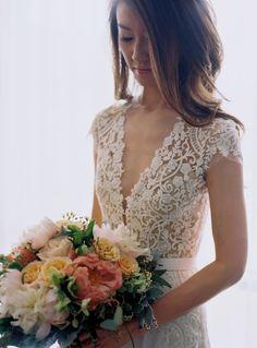 V neck embroidered lace wedding dress: http://www.stylemepretty.com/massachusetts-weddings/salem-ma/2016/01/06/backyard-seaside-massachusetts-wedding/ | Photography: Charlotte Jenks Lewis - http://charlottejenkslewis.com/