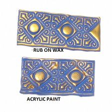 Rub on waxes: Another type of infusion that you can use with polymer clay are Rub ons. These are normally used for scrap booking or card making. They are like small cakes with waxy pigment. You can rub them onto raw or cured clay with your fingers