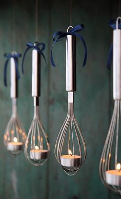 Hanging whisk tealight holders.