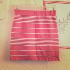 """Coral mini skirt with white stripes Super cute summer mini skirt, a beautiful coral-melon color with thin white striped ribbing and elastic waistband for great fit. Size is Medium but is stretchy so should work for a variety of sizes; waist measurement is 12"""" laid flat and length is 14"""". In great condition! Charlotte Russe Skirts Mini"""
