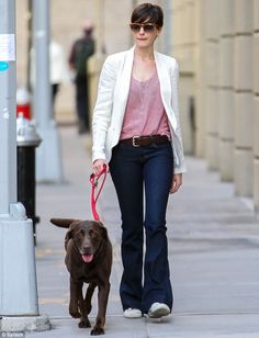 Effortlessly chic: Anne Hathway would have no doubt left her fellow pooch owners feeling more than a little under-dressed as she stepped out on a stroll in Brooklyn, New York, on Thursday