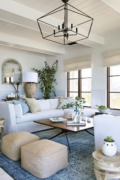 Perfect home decor for coastal living room + coastal design ideas + decorating with white neutral furniture modern living room decor, neutral living room decor with white walls and coffee table decor Coastal Living Rooms, Home Living Room, Living Room Designs, Neutral Living Rooms, Living Room Decor With White Couch, Living Room Ideas Light Blue, Living Room Chandeliers, Lights For Living Room, Family Room With Sectional