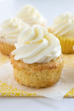 Pineapple Cupcakes with Whipped Coconut Buttercream Frosting | bakedbyanintrovert.com