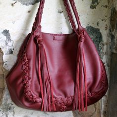 The Shoulder Bag is handmade in our studio in Athens . Classic styling and premium quality cowhide leather makes this wonderful Bordeaux tote bag. Features signature hand braiding throughout and long fringes both sides. Long Fringes, Cowhide Leather, Bordeaux, Shopping Bag, Shoulder Bag, Tote Bag, Trending Outfits, Unique Jewelry, December