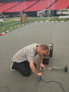 Its me seaming carpet together at the Georgia Dome June 2016.There were two 60ft seams on the 10 yard line.
