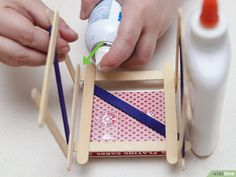 How to Build a Popsicle Stick Tower. Popsicle stick towers are a common engineering project to be assigned in school.Your assignment may have various criteria for height, weight, and number of popsicles, but this guide will give you a. Diy Wood Projects, Home Projects, Engineering Projects, Wood Glue, Popsicle Sticks, Popsicles, Open House, Plastic Cutting Board, Tower
