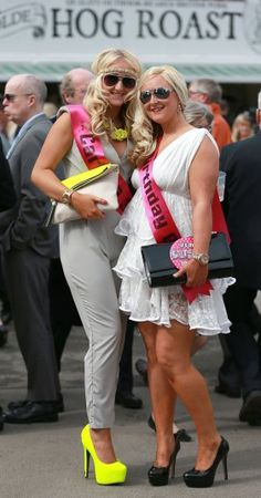 Racegoers arrive for 'Ladies Day' at the Grand National horse race meeting at Aintree in Liverpool OMG look at her legs..... the one on the right!