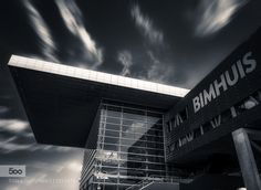 Bimhuis Amsterdam - Pinned by Mak Khalaf The Bimhuis is a concert hall for jazz and improvised music in Amsterdam. With an average of 150 performances a year the Bimhuis is the main stage for these musical genres in the Netherlands. The Bimhuis was founded in 1973. Since January 2005 it is housed in this new building at the Piet Heinkade 3 next to the Muziekgebouw aan 't IJ on the southern bank of the IJ river. City and Architecture AmsterdamArchitectureBlack and…