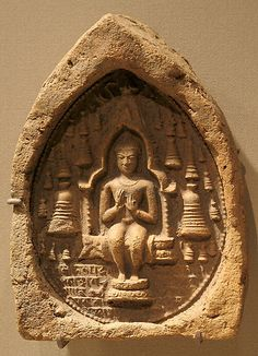 Votive Plaque with a Seated Buddha Pala period.9th century India. Terracotta