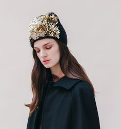 A stunning hand knit beanie with golden embroidery detail. Made by hand in New York City.  We ship worldwide! Orders ship within 3-5 business days. Please email shop@jenniferbehr.com or call 718-360-1875 to request expedited shipping. We are a small team and are happy to answer your questions 10am - 6pm, Monday - Friday :) $2,200.00