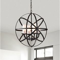 Unique and engaging, this chandelier will add a dash of urban appeal to your room. The globe chandelier is crafted from crossing bands of metal. Four candle-like lights rest inside the globe. Striking