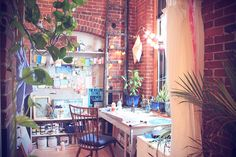 I just love the walls, the lights, the window, the plants, the furniture...it's so perfect.