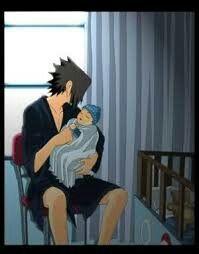 Una foto in cui Sasuke tiene in braccio una delle sue figlie da piccola