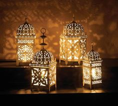 Enjoy the beauty of a candle lantern with the flick of a switch instead of a strike of a match! This Moroccan-style lantern features a single bulb inside that w