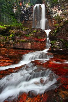 Glacier National Park, Montana--Nature showing off with a splash of color. Beautiful Waterfalls, Beautiful Landscapes, Places Around The World, Around The Worlds, Beautiful World, Beautiful Places, Beautiful Pictures, Landscape Photography, Nature Photography