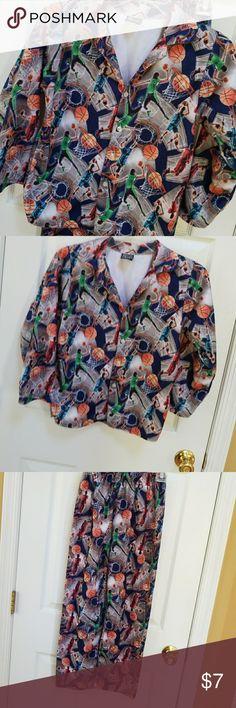 "Boy's pajama set Boy's size 16/18 pj set. Basketball theme. Long sleeves. Length shirt 21"", pants waist 20-26"" elastic waist, length 34"". still in good condition. none Pajamas Pajama Sets"