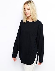 Super cool black denim sweater - would love to wear this over a white shirt. Perfect for work and everyday wear!  Find it here: http://asos.to/1laNrO7