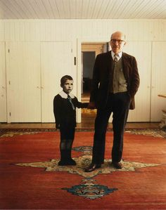 Saul Steinberg (holding hands with a lifesized photo of himself as a small boy)