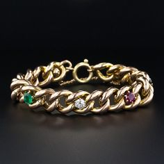 Antique  Multi-Gem Curb Chain Bracelet | A fun and festive gold bracelet dating back to Victorian times, in softly patinated rose-yellow gold and colorized all round with one each of the following gems: diamond, emerald, ruby, pearl, amethyst and sapphire (that just about covers everything!).