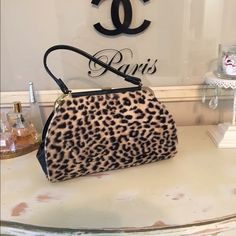 Vintage Leopard Handbag Leopard purse in very good condition. Sometimes the clasp is hard to keep shut. Just make sure to tightly close and it will be fine. Interior is fabric lined with zipped pocket. Bags Satchels