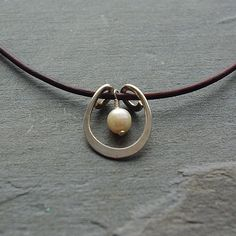 A personal favorite from my Etsy shop https://www.etsy.com/listing/215757916/modern-pendant-pearl-necklace-argentium