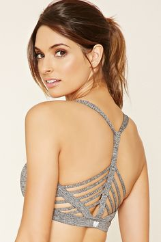In a heathered stretch knit, this low impact sports bra features a strappy caged-cutout back, removable cups, and moisture management.