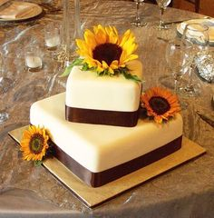 Cake idea. I like the angled arrangement but forget the sunflowers.