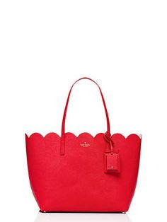 our lily avenue carrigan tote is technically an all-season bag. but the light hue and unique, scallop-edged top feel very right for spring. carry it with a colorful shirtdress or jeans and a white t-shirt, while wearing your favorite pair of sunglasses.