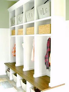 for a laundry room or mud room, and I love those crates with the kids initials on them