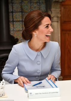 Kate laughs as she prepares to convene a round-table discussion on the themes of addiction...