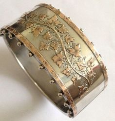 Victorian Sterling Silver & Rose Gold Decorated Hinged Bangle - repinning this as I own am identical one. Astonished to find this here.