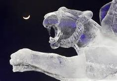 """The crescent moon is seen behind an ice sculpture during ice and snow sculptures festival at the """"Eight Lakes"""" Park-Resort outside Almaty January - REUTERS/Shamil Zhumatov/KAZAKHSTAN Snow Sculptures, Sculpture Art, Ice Photo, Ice Art, Snow Art, Park Resorts, Snow And Ice, Foto Art, Kazakhstan"""
