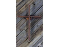 A personal favorite from my Etsy shop https://www.etsy.com/listing/468304166/cabin-wall-cross-antiqued-walnut