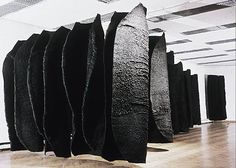 Magdalena Abakanowicz -  Black Environment 1970-78, sisal weaving, fifteen pieces each on metal support