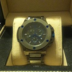 Geneva mens watch Worn twice, no scratches, unscratchable  metal. Has extra links and comes in original box. Jewelry