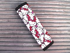 Seat Belt Strap Cover; Hello Kitty/Hot Pink on reverse/Spring Ribbon Accent by Comfy Accessories