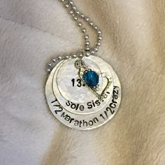 Each aluminum disc is hand stamped with a name and accented with a crystal.    Discs hang from an 24 aluminum ball chain.    Please leave instructions in the message to seller box during checkout with the color of stone and an alternate charm if youd like.    Price is for three discs, if a different number of discs is needed please contact me prior to purchase.    Thank you for stopping by