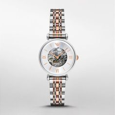 Retro Watch The slim multi-link two-tone bracelet of this Emporio Armani ladies' watch keeps the focus on the skeleton Meccanico dial, trimmed with a white mother-of-pearl index ring and rose gold-tone indexes.