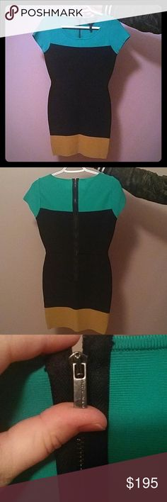 BCBG Max Azria dress BCBG MAX AZRIA color block dress size medium. Teal, navy blue, and dark tan cap sleeve fitted dress with a round scoop neck. Has a zipper at the back and metal hook and eyelet closure. Never worn. BCBGMaxAzria Dresses Midi