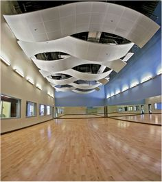 Promoting health and wellness, About Family Fitness Center in Coral Springs, Florida, features a curving metal ceiling system installed by Acousti Engineering Company of Florida. Designed by Synalovski, Gutierrez & Romanik, the project's aluminum ceiling system offers a modern aesthetic with the ability to control acoustics in noisy gymnasiums and exercise classrooms.