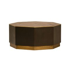 Solid wood octagonal coffee table with brass base and detail around top. The sides are a dark, smooth wood and the top is a slightly lighter wood with interesting texture. Hand-waxed finish.