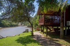 Riverfront self catering timber chalet for a family of 4.