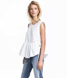 Check this out! Sleeveless top in woven cotton fabric with drawstrings at sides, seam at waist, and a wide, flared flounce at hem. - Visit hm.com to see more.