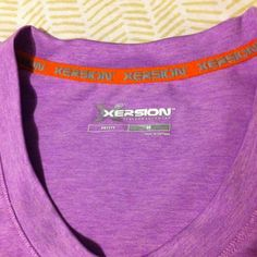 """Purple v neck workout top Size petite medium. This carried through my last 2 trimesters of pregnancy for working out. Not a maternity top, but roomy if you are normally size small. The material is a """"dri fit"""" type. xersion Tops Tees - Short Sleeve"""