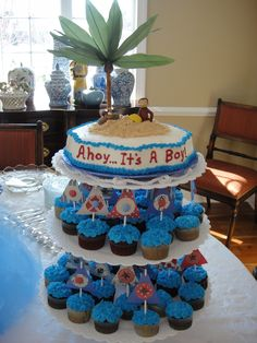 'Ahoy Its A Boy' Nautical Baby Shower theme. Sailboat cupcakes and 'island cake'