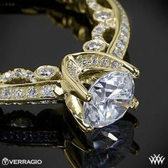 This Diamond Engagement Ring is from the Verragio Paradiso Collection. It features 0.60ctw of Round Brilliant Diamond Melee (F/G VS) that enhance a round diamond center of your choice. The width tapers from 3.2mm at the top down to 2.1mm at the bottom. Select your diamond from our extensive online diamond inventory. Please allow 4 weeks for completion. Platinum rings carry a 5 week turnaround time. If you have any questions regarding this item then please contact one of our friendly diamond…