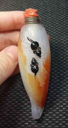 Carved Chinese agate snuff bottle with mouse and corn design. Would make a much nicer scent bottle instead.