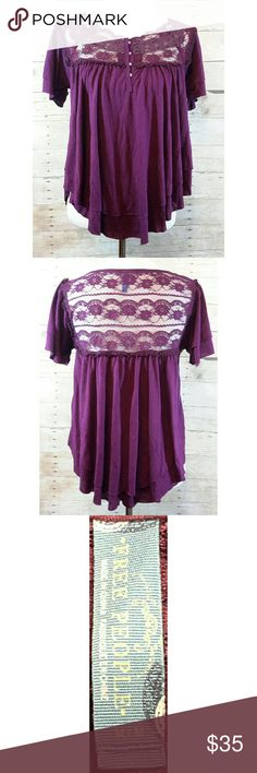 Free People Flowy Double Layer Top with Lace My pictures do not do this Free People top any justice.  It is a gorgeous plum color with a yoke lace insert on the front and back.  It has short flutter sleeves and is a lightweight double layer body with a side wave.  It is a size medium.  The body is 65% polyester and 35% rayon. The lace is 100% nylon.  All items are from a non smoking and pet friendly home. Bundles welcome.  Any questions, please let me know.  Offers welcome, please use the…