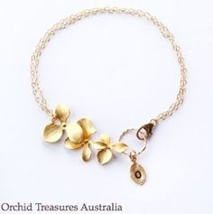 This gorgeous orchid charm bracelet is ideal for any special occasion.    Handmade sterling silver bracelet with white gold plated orchids to offer a stunning and delicate piece to accompany the perfect dress. Attached is a hand-stamped Initial leaf. Please select your letter.  Extra charms can be added such as small real orchids preserved in resin and extra sterling silver engraved orchid leaves. $45 Handmade Sterling Silver, Sterling Silver Bracelets, Gold Necklace, Orchid Leaves, Hand Stamped, Orchids, Special Occasion, Initials, Resin